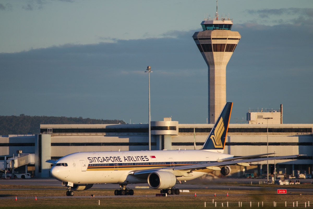 9V-SQL Boeing 777-212ER (MSN 33370/451) of Singapore Airlines, at Perth Airport - Wed 6 May 2015. Flight SQ214 to Singapore, taxying out to runway 21 at 5:13pm, with Terminal 1 and the Control Tower behind. Photo © David Eyre