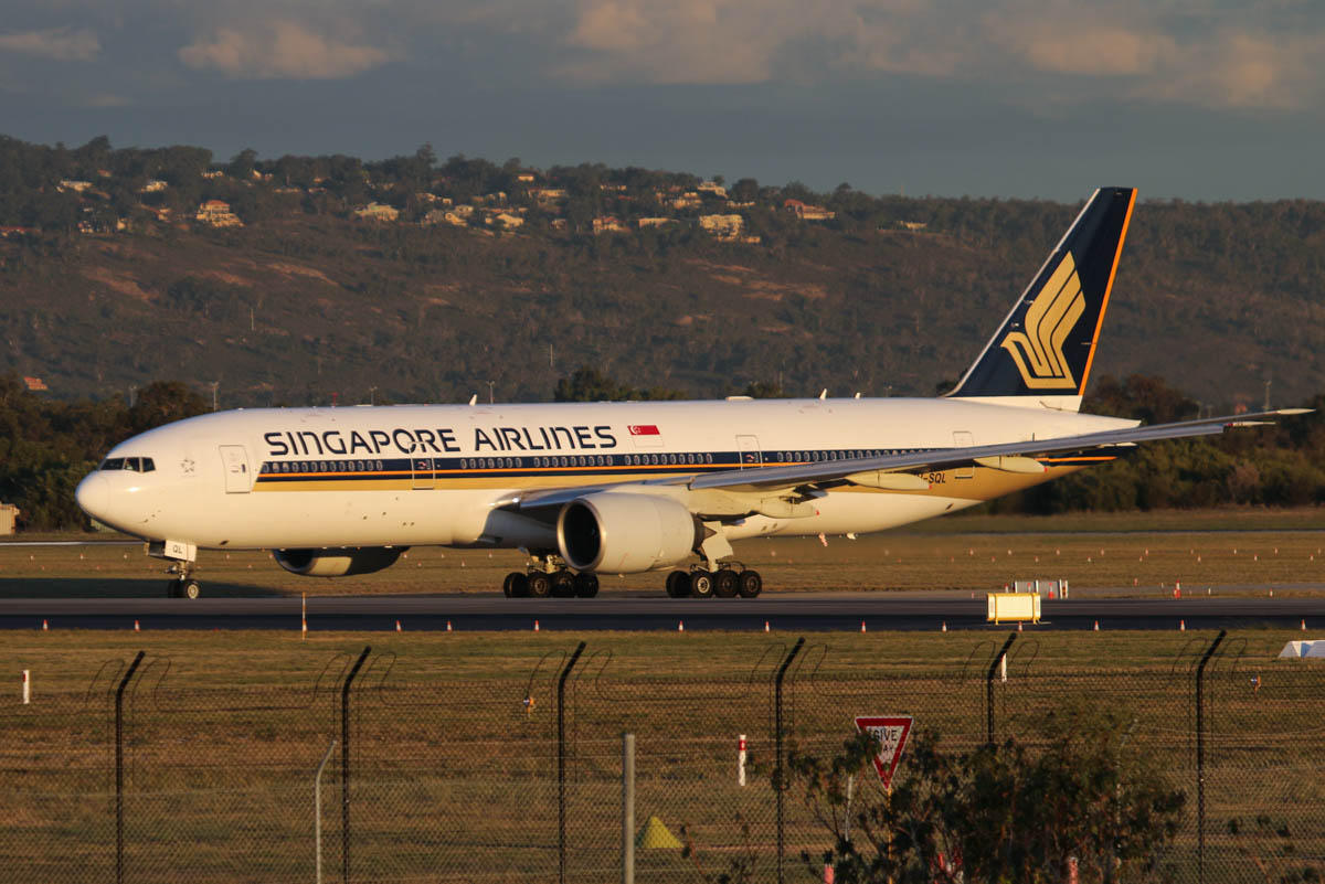 9V-SQL Boeing 777-212ER (MSN 33370/451) of Singapore Airlines, at Perth Airport - Wed 6 May 2015. Flight SQ214 to Singapore, taxying out to runway 21 at 5:14pm, with the hills of the Darling Range behind. Photo © David Eyre