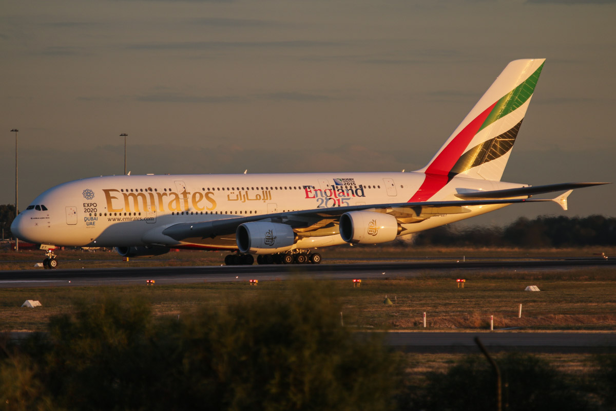 A6-EET Airbus A380-861 (MSN 142) of Emirates, with World Cup 2015 - England 2015' decals on the rear fuselage, at Perth Airport - Wed 6 May 2015. First visit to Perth. Flight EK420 from Dubai. After landing on runway 21 at 5:12pm, due to taxiway works, the aircraft had to taxi up taxiway A, past Terminals 3 and 4, then had to hold on taxiways D and N before crossing runways 21 and 24 and via taxiway S to the international apron and Bay 51. Photo © David Eyre
