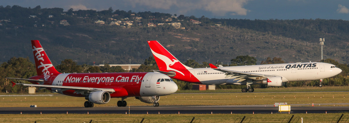 PK-AXG Airbus A320-216 (MSN 3813) of Indonesia AirAsia, and VH-EBB Airbus A330-202 (MSN 522) of Qantas, named 'Albany', at Perth Airport - Wed 6 May 2015. PK-AXG is operating flight QZ545 to Bali, taxying onto runway 21 at 4:49pm. In the background is VH-EBB landing on runway 24 as QF777 from Melbourne. Photo © David Eyre