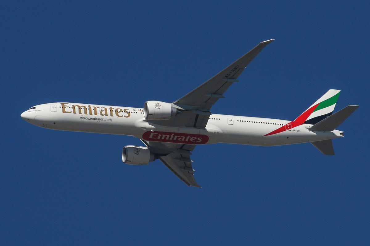 A6-ENU Boeing 777-31HER (MSN 41367/1236) of Emirates over the northern suburbs of Perth - Wed 27 May 2015. Flight EK422 from Dubai, heading northeast along the 9 DME arc at 12:00pm, before joining the approach to Perth Airport's runway 21. Photo © David Eyre