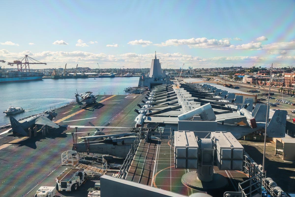 Forward end of the flightdeck of USS Bonhomme Richard (LHD-6), at Fremantle - Fri 26 June 2015. Viewed from the bridge. Visible aircraft include ten Bell Boeing MV-22B Osprey tilt rotors, one McDonnell Douglas AV-8B+ (R) Harrier II Plus and two Sikorsky MH-60S Seahawks. In the foreground on the right are the RIM-116 Rolling Airframe Missile launcher and nearest is the NATO Sea Sparrow missile launcher. Photo © David Eyre