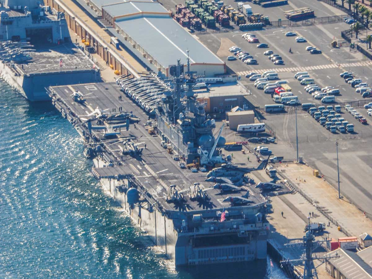 USS Bonhomme Richard (LHD-6) and USS Green Bay (LPD-20) at Fremantle Port - Sun 28 June 2015. Aerial photo taken at 1,500 feet. Aircraft aboard USS Bonhomme Richard included MV-22B Ospreys of VMM-265, AV-8B Harrier IIs of VMA-311, CH-53E Super Stallions of HMH-462, and MH-60S Seahawks of HSC-25 Detachment 6. Aboard the USS Green Bay were AH-1W Super Cobras and UH-1Y Venoms of HMLA-269. Photo © Nick Tantra