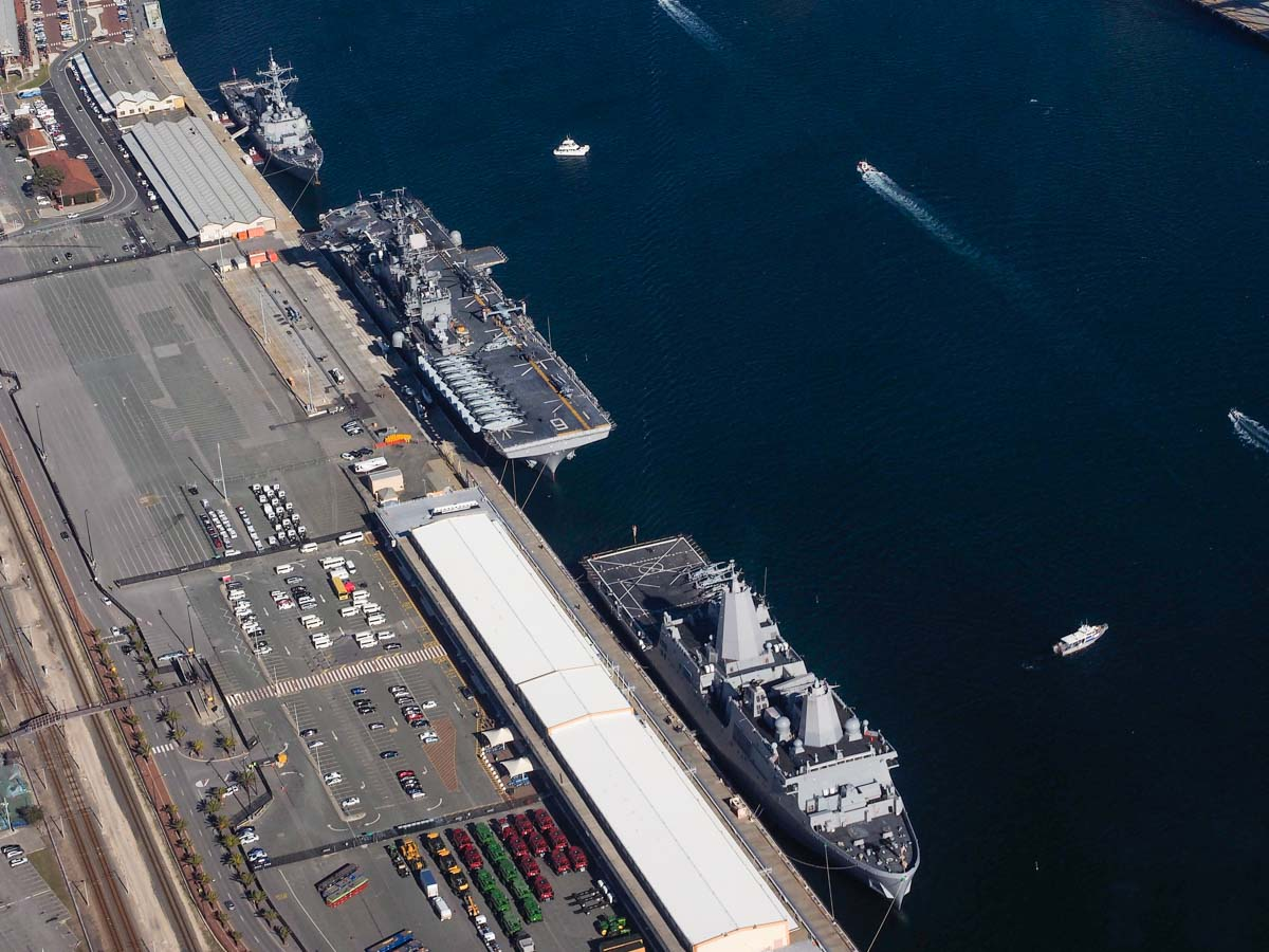 USS Preble (DDG-88), USS Bonhomme Richard (LHD-6) and USS Green Bay (LPD-20) at Fremantle Port - Sun 28 June 2015. Aerial photo taken at 1,500 feet. Aircraft aboard USS Bonhomme Richard included MV-22B Ospreys of VMM-265, AV-8B Harrier IIs of VMA-311, CH-53E Super Stallions of HMH-462, and MH-60S Seahawks of HSC-25 Detachment 6. Aboard the USS Green Bay were AH-1W Super Cobras and UH-1Y Venoms of HMLA-269. USS Preble had two MH-60R Seahawks of HSM-37 Detachment 5 in the hangars. Photo © Nick Tantra
