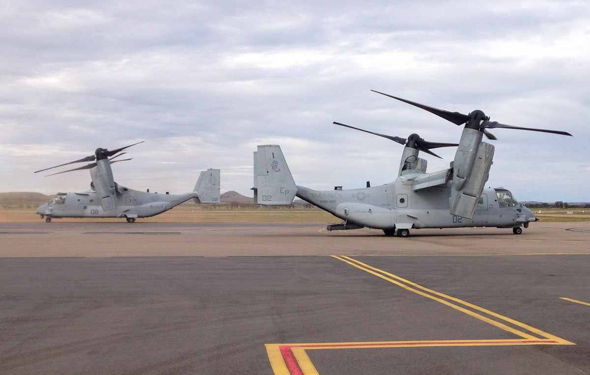 168219/EP-02 (MSN D0169) and 168031/EP-08 (MSN D0161) Bell Boeing MV-22B Osprey of VMM-265 'Dragons', US Marine Corps, at Geraldton Airport - Wed 1 July 2015. These two Ospreys, callsigns DRAGON 01 and DRAGON 02 flew from USS Bonhomme Richard (LHD-6) on a medevac flight to drop off a sailor who was ill. They arrived just before 3pm, did not refuel and only stayed a few minutes. The ship had departed Fremantle the previous day after a port visit and was on its way to take part in Exercise Talisman Sabre 2015 off Darwin and Central Queensland. Photo © Alastair Urquhart