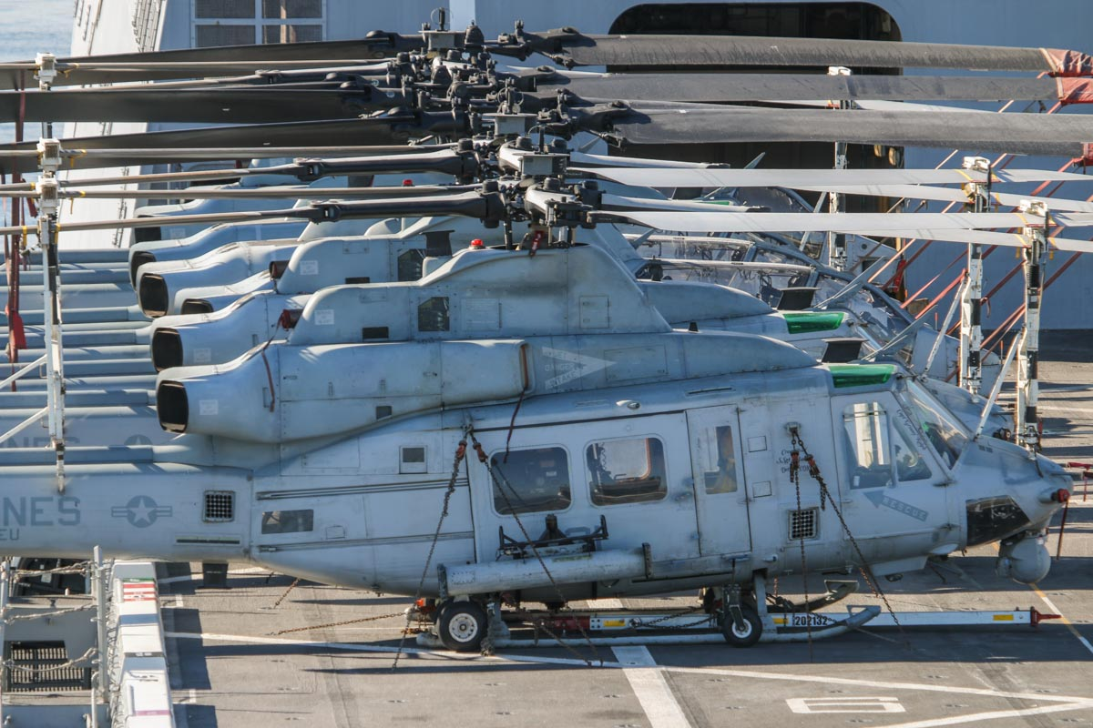 "Bell AH-1W Super Cobras and Bell UH-1Y Venoms of HMLA-269 ""The Gunrunners"", USMC, aboard USS Green Bay (LPD-20), at Fremantle - Fri 26 June 2015. Furthest to nearest are: 162550/41 Bell AH-1W Super Cobra (MSN 26219/29155); 168409/32 Bell UH-1Y Venom; 165392/45, 160801/52 (MSN 26901) and 165319/42 (MSN 26343) AH-1W; 168407/30 and 168408/31 AH-1Y. Photo © David Eyre"