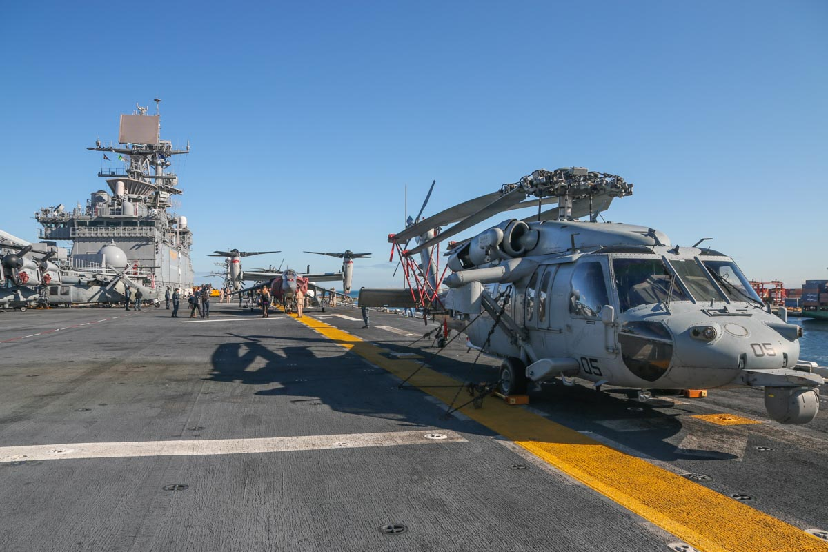 "168546/RB-05 Sikorsky MH-60S Seahawk (MSN 70-3971) of HSC-25 Detachment 6 ""Island Knights"", USN, aboard USS Bonhomme Richard (LHD-6), at Fremantle - Fri 26 June 2015. Other aircraft visible include: another MH-60S of the same squadron on the left - 167889/RB-03 (MSN 70-3894); 168216/EP-10 (MSN D0166) (far left) and 168220/EP-00 (MSN D0170) Bell Boeing MV-22B Osprey of VMM-265 'Dragons'; 165567/WL-00 McDonnell-Douglas AV-8B+ (R) Harrier II Plus (cn B304, ex 163662) of VMA-311 'Tomcats, USMC. Photo © David Eyre"