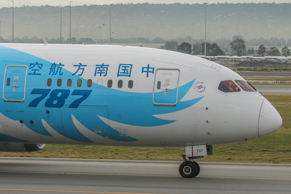 B-2737 Boeing 787-8 Dreamliner (MSN 34930/104) of China Southern, at Perth Airport - Fri 26 June 2015. First Officer waving to spectators at the Viewing Area. Flight CZ320 to Guangzhou, taxying on taxiway A to runway 03 at 9:19am for departure. The next day, taxiway C11 opened, and international flights no longer follow this route to runway 03. Photo © David Eyre