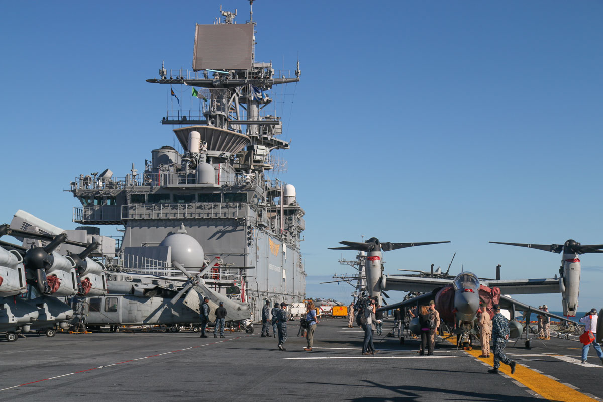 Forward end of the flight deck of USS Bonhomme Richard (LHD-6), at Fremantle - Fri 26 June 2015. Aircraft visible include: Bell Boeing MV-22B Osprey of VMM-265 'Dragons', USMC: 168223/EP-03 (MSN D0173), 168216/EP-10 (MSN D0166) (both on the far left) and 168220/EP-00 (MSN D0170) (behind the Harrier); 167889/RB-03 Sikorsky MH-60S Seahawk (MSN 70-3894) of HSC-25 Detachment 6 'Island Knights', USN (one the left); 165567/WL-00 McDonnell-Douglas AV-8B+ (R) Harrier II Plus (cn B304, ex 163662) of VMA-311 'Tomcats, USMC. Photo © David Eyre