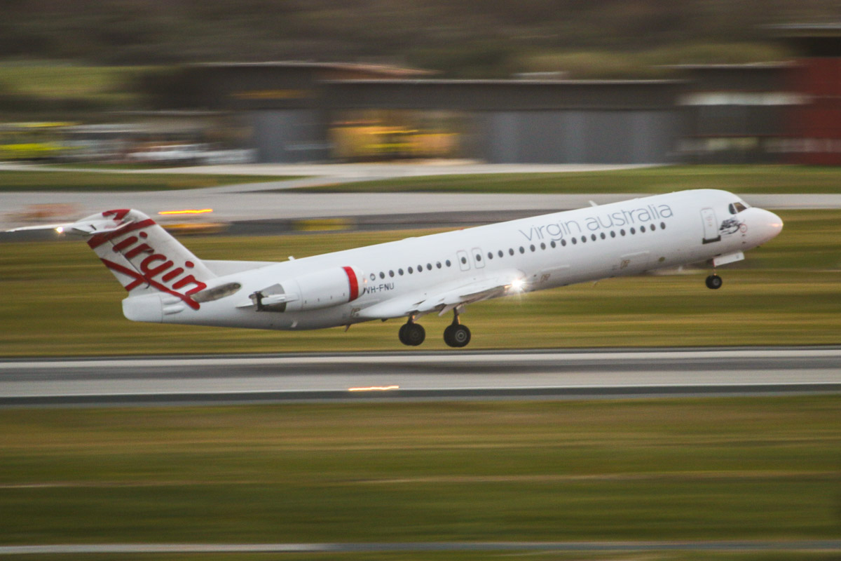 VH-FNU Fokker 100 (MSN 11333) of Virgin Australia Regional Airlines, named 'Roebuck Bay', at Perth Airport – Fri 26 June 2015. Flight VA1481 to Broome, taking off from runway 06 at 7:20am. Photo © David Eyre