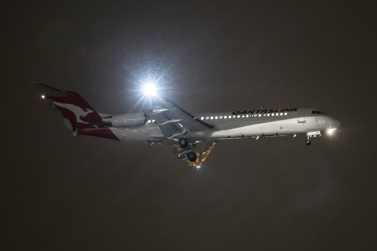 VH-NHY Fokker 100 (MSN 11467) of QantasLink (Network Aviation) at Perth Airport - Thu 30 July 2015. Seen arriving on delivery to Perth, landing on runway 03 at 8:22PM on a wet and windy night, arriving from Townsville via Alice Springs. Formerly PR-OAQ with Avianca Brasil, and prior to that N1455K with American Airlines. VH-NHY arrived in Australia on its delivery flight from Europe on 15 July 2015, flying to Townsville, where it was repainted in QantasLink livery - the first Network Aviation Fokker 100 to be painted in this livery. Photo © Marcus Graff