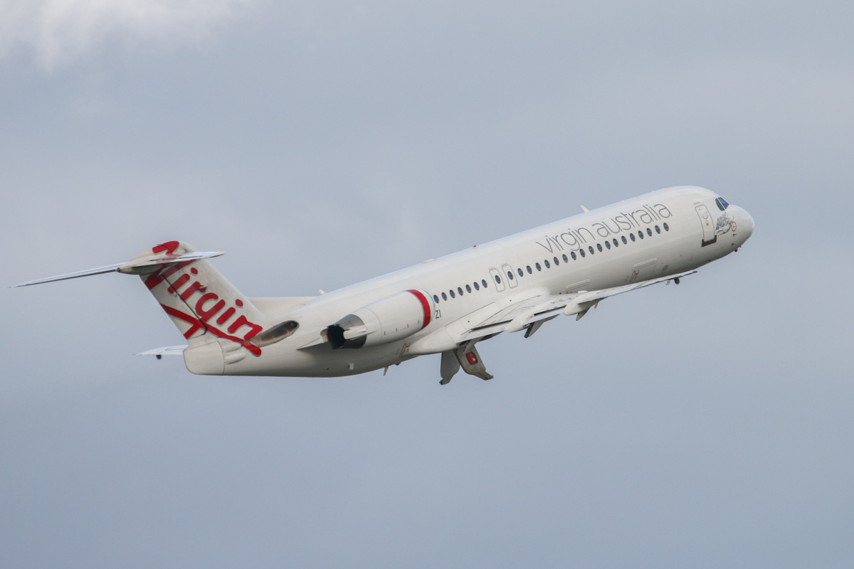 VH-FZI Fokker 100 (MSN 11333) of Virgin Australia Regional Airlines, at Perth Airport - Tue 11 August 2015. Flight VA9307 to Onslow, climbing after take-off from runway 21 at 3:53pm. Likely to be a FIFO charter flight carrying workers to Chevron's Wheatstone LNG project. Photo © David Eyre