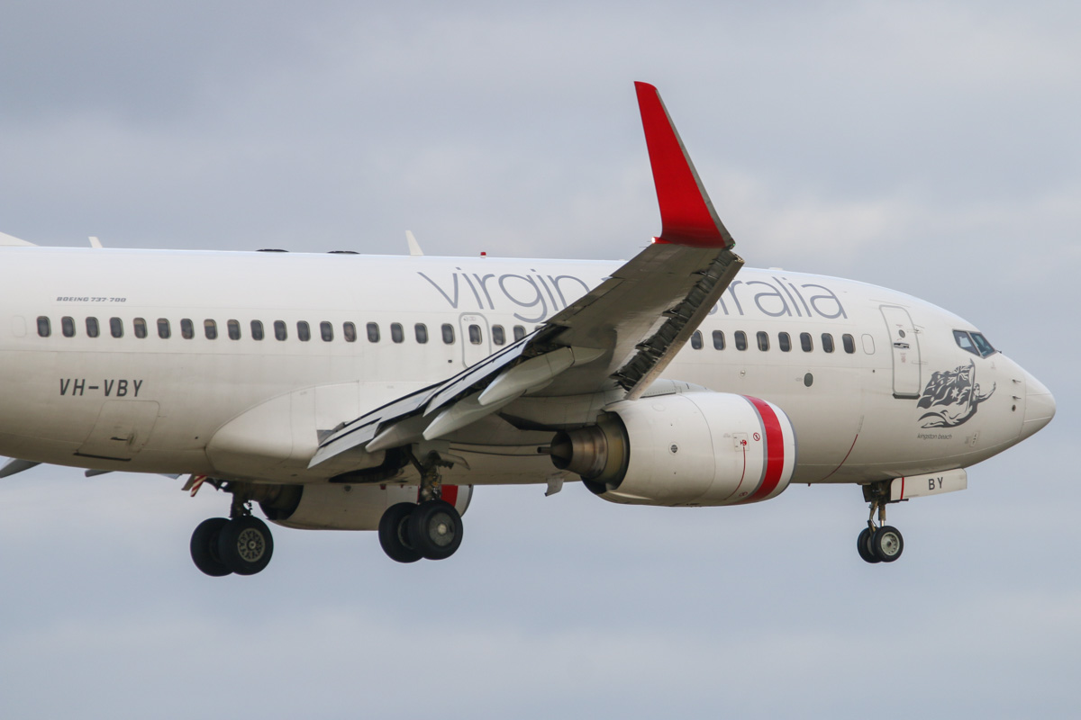"""VH-VBY Boeing 737-7FE (MSN 34323/1751) of Virgin Australia, named """"Kingston Beach"""" at Perth Airport – Tue 11 August 2015. Flight VA1484 from Broome, landing on runway 21 at 4:19pm. One of only two 737-700s remaining in Virgin Australia's fleet. Photo © David Eyre"""