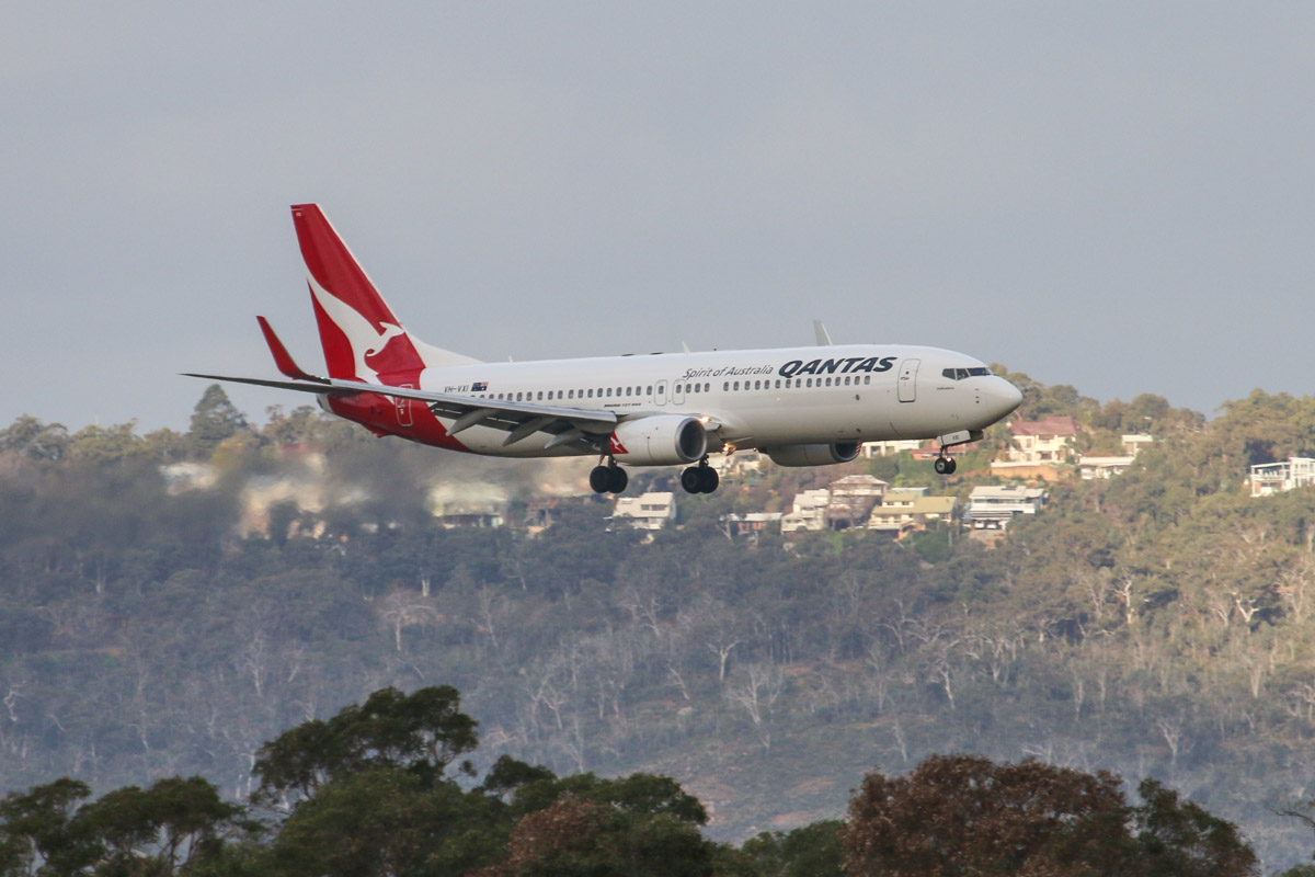 VH-VXI Boeing 737-838 (MSN 33479/1141) of Qantas, named 'Oodnadatta', at Perth Airport - Tue 11 August 2015. Landing on runway 24 with the hills of the Darling Range as a backdrop, as QF585 from Adelaide at 4:23pm. Photo © David Eyre