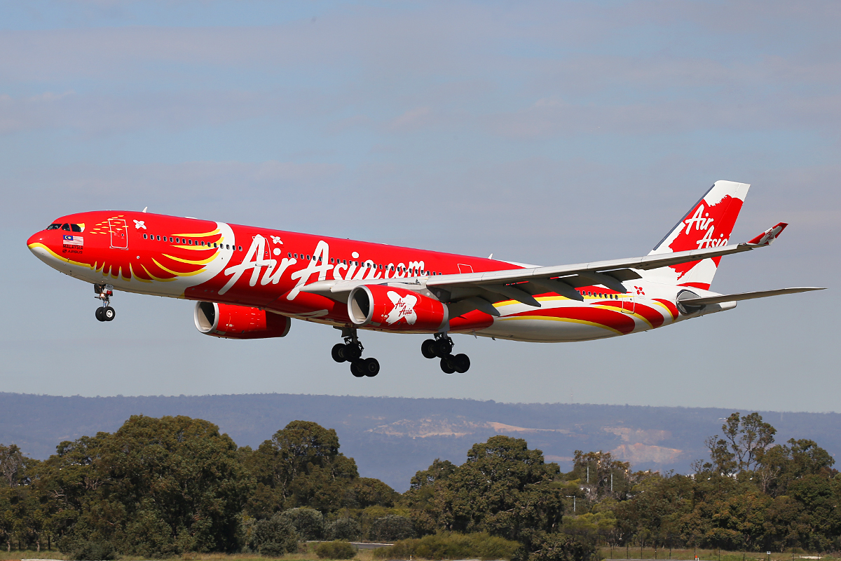 "9M-XXT Airbus A330-343 (MSN 1549) of Air Asia X in special ""Xcintillating PhoeniX"" livery at Perth Airport – 27 August 2015."