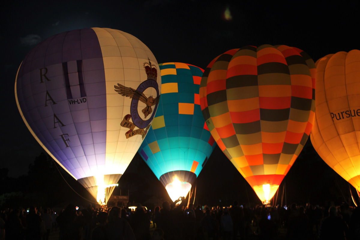 Balloons VH-LVD, VH-FEQ, VH-OTR, and VH-BLQ at Henry Street Oval, Northam - Sat 29 August 2015. The 'Balloon Glow' event at the Shire of Northam's Family Balloon Fiesta, held during the National Ballooning Championships. Photo © Jonathan Williams