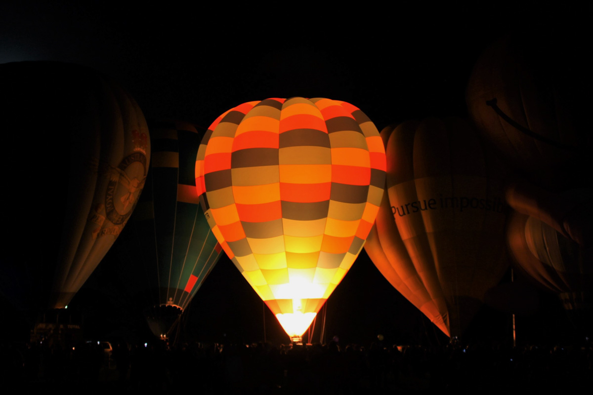 Balloons VH-LVD, VH-FEQ, VH-OTR, VH-BLQ, and VH-NUD, at Henry Street Oval, Northam - Sat 29 August 2015. The 'Balloon Glow' event at the Shire of Northam's Family Balloon Fiesta, held during the National Ballooning Championships. Photo © Jonathan Williams