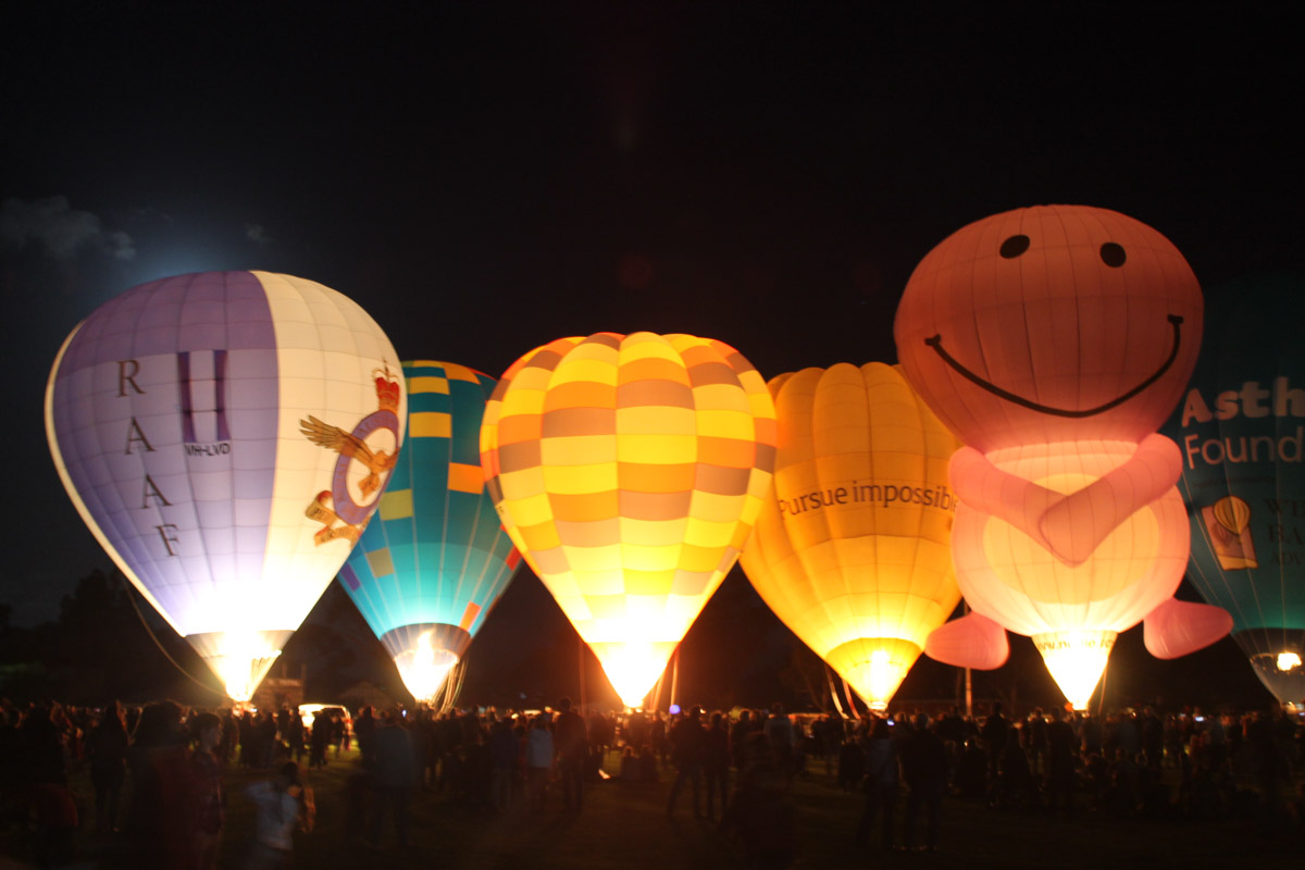 Balloons VH-LVD, VH-FEQ, VH-OTR, VH-BLQ, VH-NUD, and VH-UAF at Henry Street Oval, Northam - Sat 29 August 2015. The 'Balloon Glow' event at the Shire of Northam's Family Balloon Fiesta, held during the National Ballooning Championships. Photo © Jonathan Williams
