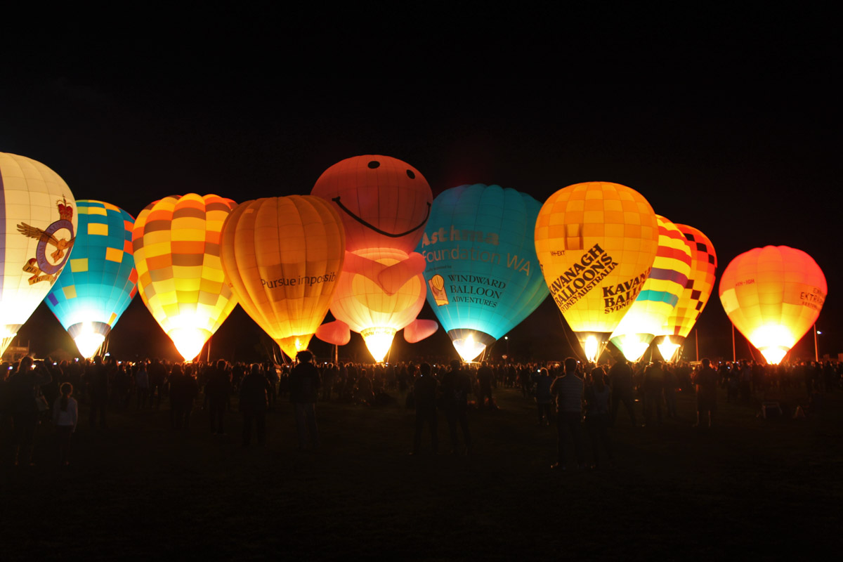 Balloons VH-LVD, VH-FEQ, VH-OTR, VH-BLQ, VH-NUD, VH-UAF, VH-EXT, VH-ACU, VH-YXY, and VH-IGH at Henry Street Oval, Northam - Sat 29 August 2015. The 'Balloon Glow' event at the Shire of Northam's Family Balloon Fiesta, held during the National Ballooning Championships. Photo © Jonathan Williams