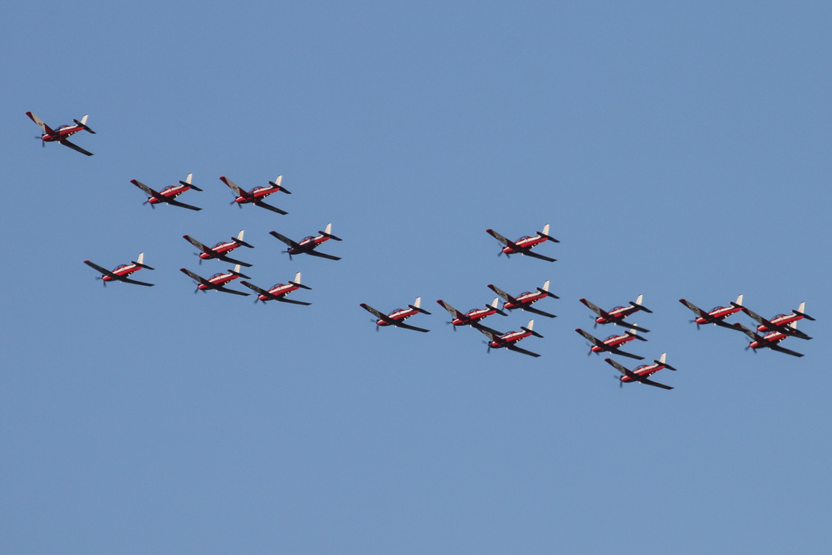 19 Pilatus PC-9/A aircraft of 2 Flying Training School (2FTS), RAAF, based at Pearce, WA, in Thunderbird formation over the northern suburbs of Perth – Wed 2 September 2015. Aircraft in the formation are A23-002, A23-003, A23-005, A23-010, A23-011, A23-014, A23-015, A23-016, A23-019, A23-021, A23-026, A23-033, A23-034, A23-038, A23-044, A23-047, A23-048, A23-054, A23-065, plus another unidentified PC-9 as chase plane. The 'Thunderbird' formation was a salute to Royal Australian Air Force (RAAF) and Royal Australian Navy (RAN) students of number 240 Pilots' Course who graduated as military aviators in a ceremony held the next day, on Thursday 3 September 2015 at RAAF Base Pearce, after their 38-week course with 2 Flying Training School (2FTS). The Thunderbird formation is also treated as a training activity for the student pilots. After taking off from RAAF Pearce, the aircraft gathered into their formation to the west of Gingin, before heading south west to pass over Rottnest Island at approximately 3.54pm, heading east over Fremantle at approximately 3.57pm, the follow the Swan River to pass in front of Perth city at approximately 4.00pm. They are seen here over the north eastern suburbs at 4.09pm before passing over RAAF Pearce for a flypast at 4:10pm. Photo © David Eyre