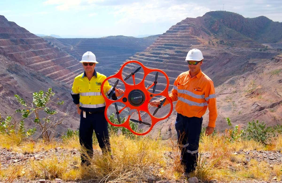 Aibotix X6 UAV being used to conduct a survey of Rio Tinto's Argyle Diamond Mine in September 2014. Since the open pit mine cannot be entered below a level of 50 meters, aerial surveying is the only possibility to detect subsidence or other potential dangers to the workers underground at an early stage. Photo © Aibotix