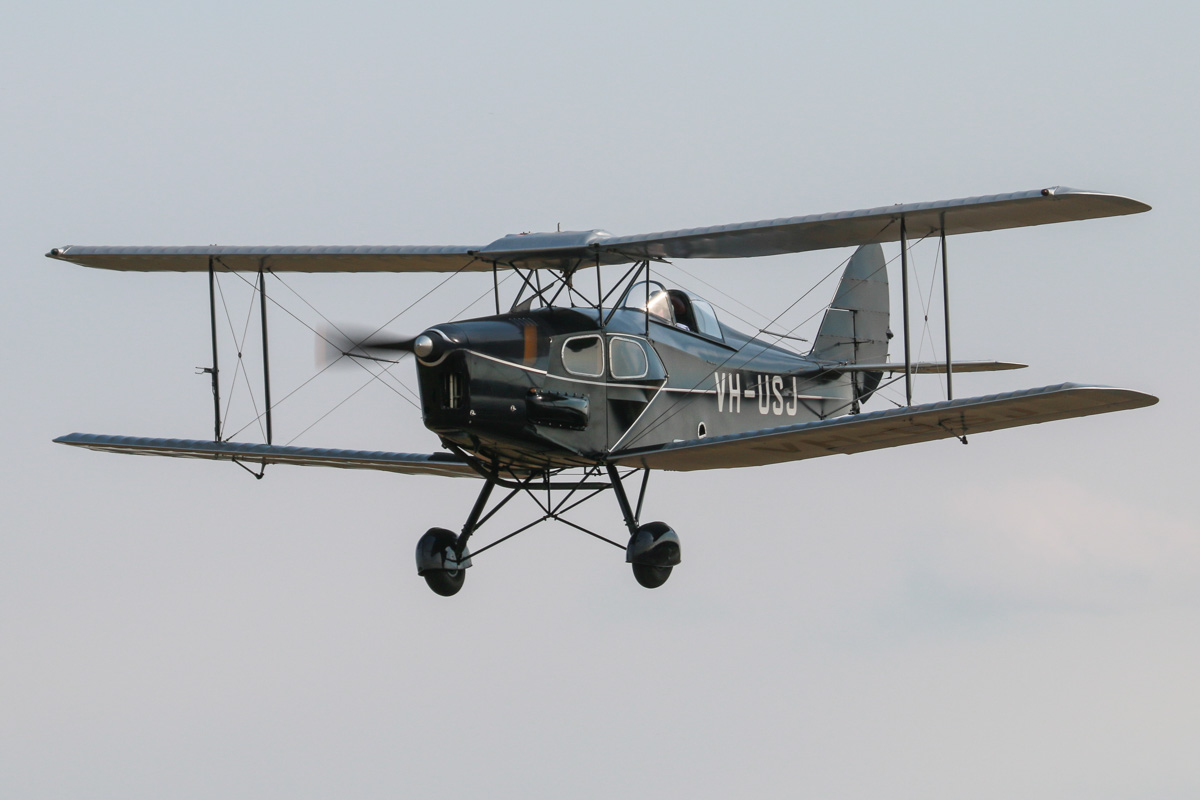 VH-USJ De Havilland DH-83 Fox Moth (MSN 4058) owned by Bert Filippi, at SABC Annual Fly-in, Serpentine Airfield - Sun 27 September 2015. Built in 1933 by De Havilland at Stag Lane Aerodrome, Edgeware, UK, and registered in 1933 as G-AECB to Scottish Motor Traction Co. Ltd., Edinburgh. In 1935, it was shipped to Fremantle, WA for MacRobertson Miller Airlines (MMA), and was registered VH-USJ. It was based in Port Hedland and operated by MMA for Australian Aerial Medical Service (AAMS), and in 1941 was sold to them. AAMS later became the Flying Doctor Service (WA Section) Inc. It was sold in 1961 and was damaged in an accident in 1964. After a series of owners and locations awaiting rebuild, in 1996, it was shipped to New Zealand and re-built. It flew again on 22 November 2002, registered as ZK-USJ, but still wearing VH-USJ. It returned to Australia in 2003 and was again registered VH-USJ. Photo © David Eyre