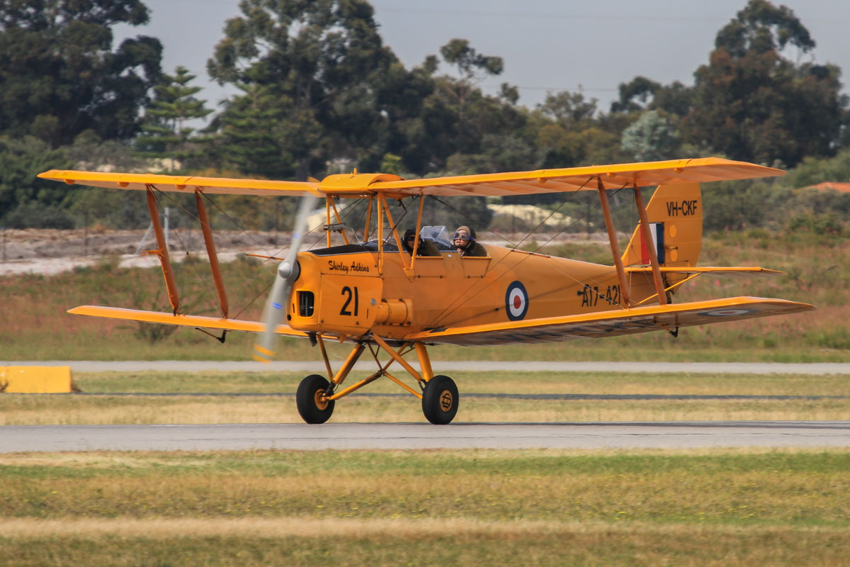 VH-CKF / A17-421 De Havilland DH-82A Tiger Moth (MSN DHA596/T200) of the Royal Aero Club of Western Australia Inc, named 'Shirley Adkins', at Jandakot Airport - Fri 2 October 2015. Landing on runway 06L. Built in 1941. Ordered for Rhodesia as DX535 but taken on RAAF charge on 4 October 1941 as A17-421. After World War Two, it was bought by Department of Civil Aviation (DCA) and converted for civil use and registered as VH-AZL on 26 June 1947. Re-registered as VH-CAG on 4 May 1949, based at Maylands. Sold to the Gliding Association of Western Australia on 5 April 1960 and reregistered 7.7.1960 as VH-TUG. Reregistered 23.10.1965 as VH-CKF. Went through a number of owners before being sold in 1986 to Reg Adkins (ex MMA DC-3, F27 & F28 pilot). It was acquired by the Royal Aero Club of WA in December 2004. Photo © David Eyre
