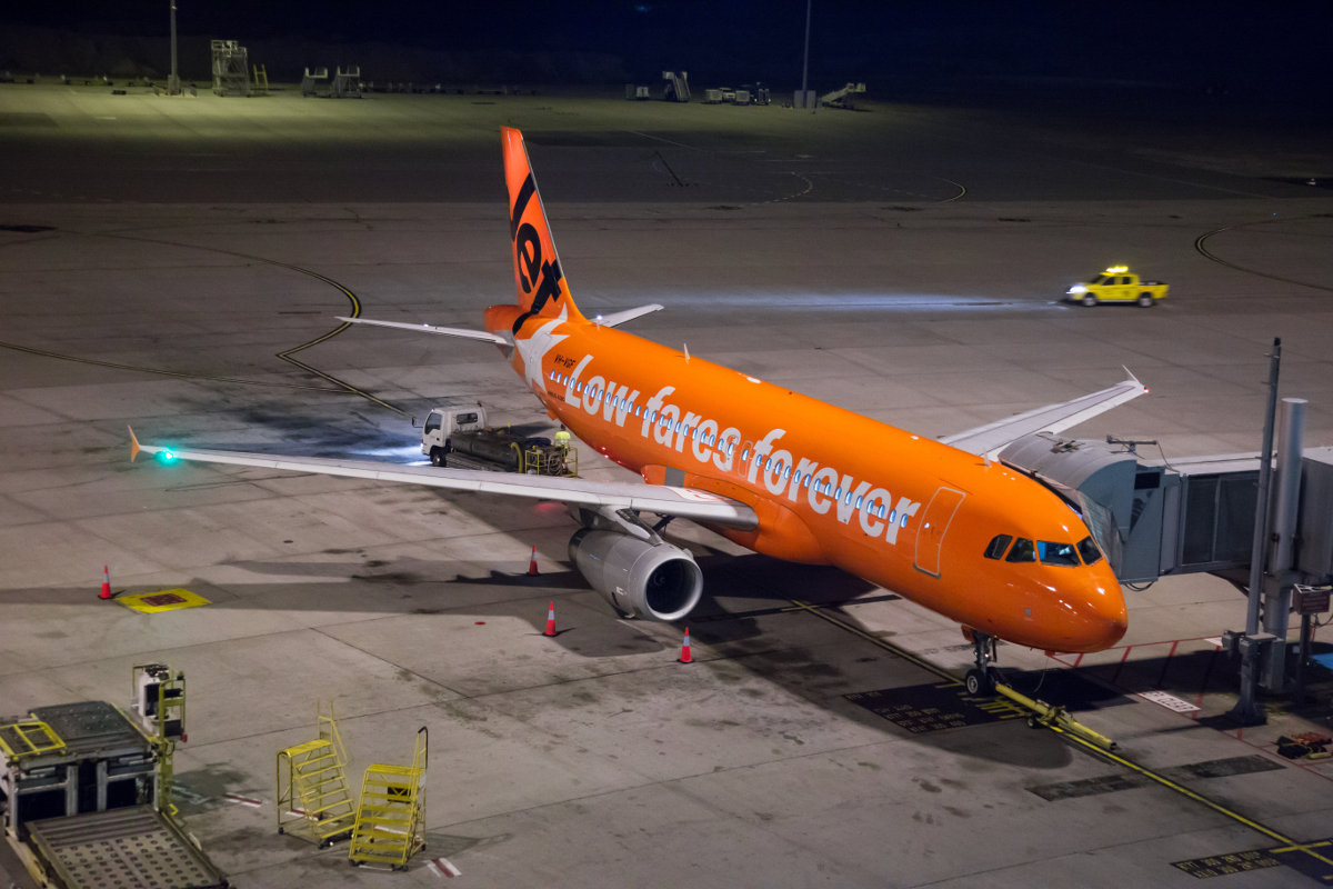 VH-VGF Airbus A320-232 (MSN 4497) of Jetstar in a special 10th Anniversary orange livery, at Perth Airport - Tue 13 October 2015. Seen parked at Terminal 1 at 8:25PM, after arriving as flight JQ109 from Denpasar (Bali) at 7:43PM. Photo © Marcus Graff