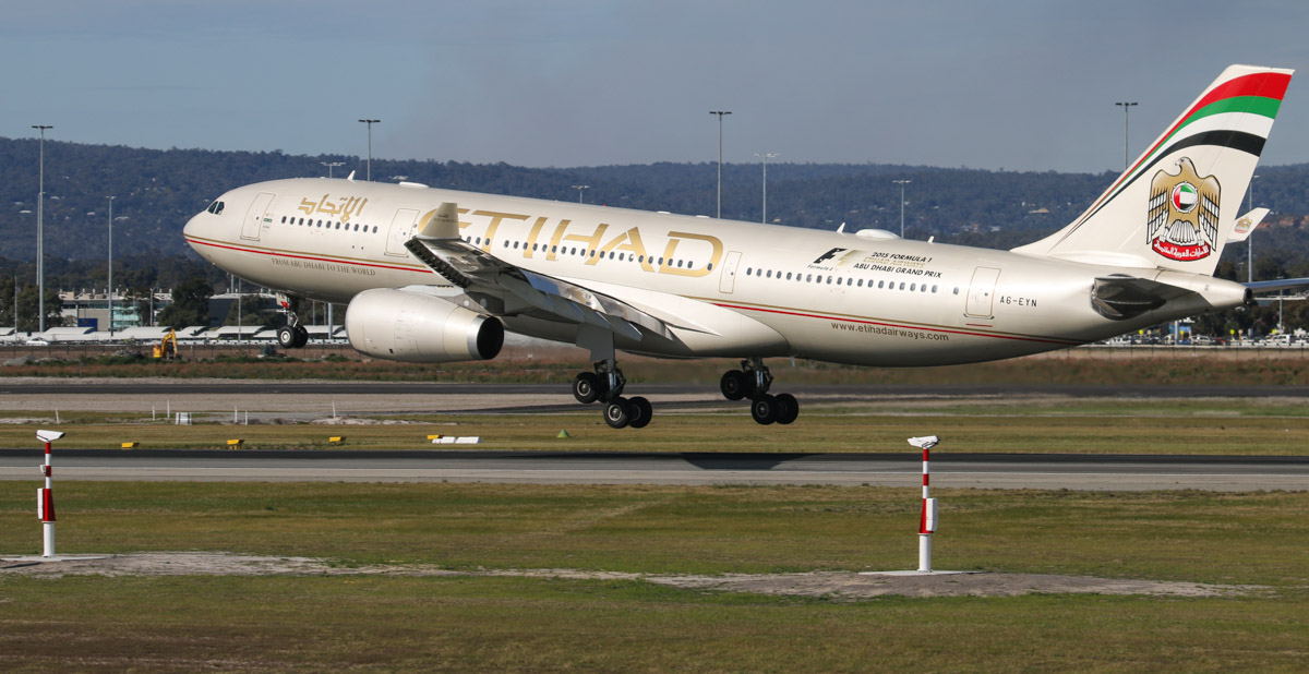 Transmissometers near the threshold of runway 03, and in the background is A6-EYN Airbus A330-243 (MSN 832) of Etihad at Perth Airport – 27 August 2015. The transmissometers (also known as hazemeters) use beams to help determine runway visibility, and will allow arriving aircraft to landing with 550 metres visibility, compared with the current 800 metres minimum. Photo © David Eyre