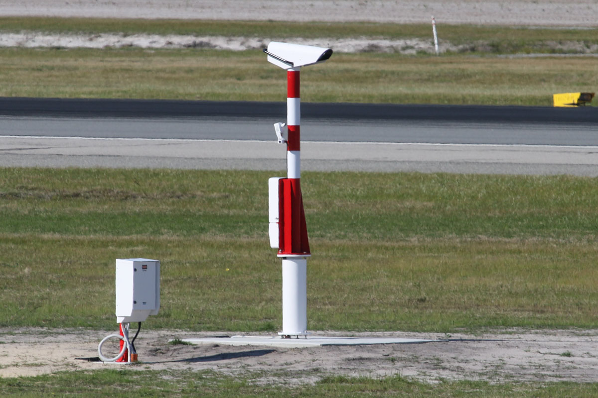Transmissometer near the threshold of runway 03 at Perth Airport – 27 August 2015. Transmissometers (also known as hazemeters) use beams to help determine runway visibility, and will allow arriving aircraft to landing with 550 metres visibility, compared with the current 800 metres minimum. Photo © David Eyre