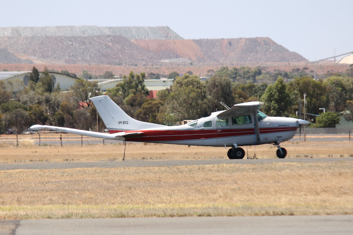 VH-BXG Cessna U206G Stationair 6 II (MSN U20605009) owned by UTS Aviation Pty Ltd, at Kalgoorlie Airport – 22 October 2015. Modified for geophysical survey work, with a magnetometer tail boom for measuring variations in the Earth's magnetic field due to changes in the magnetite content of the rock. Built in 1979, ex N4626U, VH-CRL. Photo © Jonathan Williams