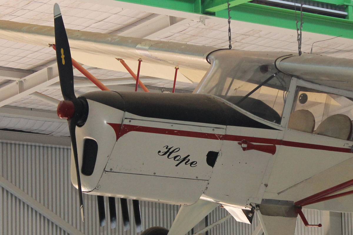 VH-KCC Auster J/5B Autocar (MSN 3251) named 'Hope', at the Australian Prospectors & Miners Hall of Fame, Kalgoorlie - 22 October 2015. Built as an Auster J5P - a model developed for Kuwait Aero Club, with higher-powered 145hp Gipsy Major 10 Mk 1 engine. Twenty J5Ps were built from 1955. VH-KCC was registered on 25.5.1956 to Kingsford Smith Aviation Services. On 26.6.1979, it was cancelled from register whilst being rebuilt. Registered again 6.7.1988 by Charles Hyland after conversion to J/5B model. It flew into Langley Park for a fly-in on 3 March 1990. On 9.8.2000, it was donated to Australian Miners & Prospectors Hall of Fame at Kalgoorlie, preserved hanging from ceiling, in the Business Of Mining Gallery. Cancelled from the register 26.6.2001. Photo © Jonathan Williams