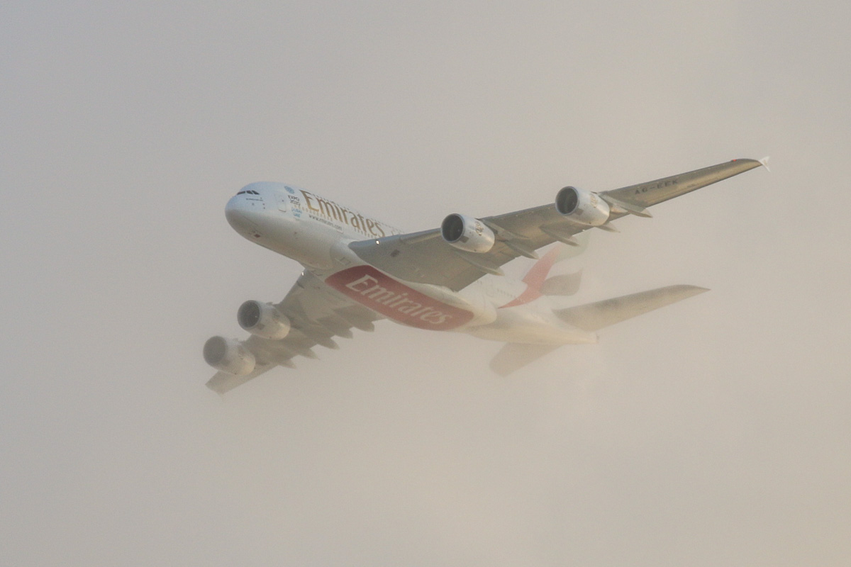 A6-EEK Airbus A380-861 (MSN 132) of Emirates, over the northern suburbs of Perth - Mon 2 November 2015. Now minus the 'Rugby World Cup 2015 - England 2015' decals that it wore until October. Flight EK420 from Dubai, about 35 minutes late, at 3,100 feet, turning northeast along the 9 DME arc before joining the approach to Perth Airport's runway 21 at 6:07pm. Photo © David Eyre