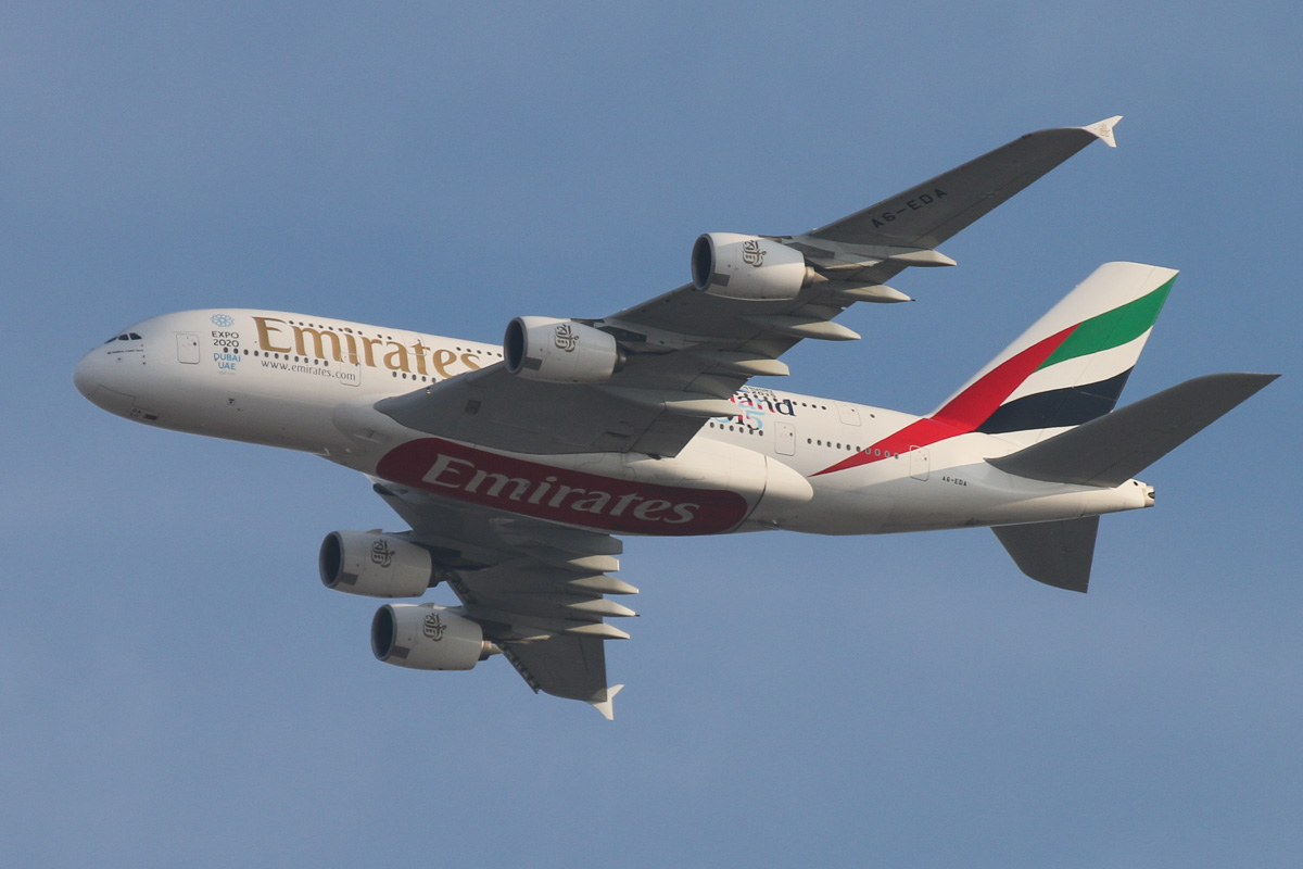 A6-EDA Airbus A380-861 (MSN 011) of Emirates, with 'Rugby World Cup 2015 - England 2015' titles, over the northern suburbs of Perth - Sat 7 Nov 2015. This was the first A380 delivered to Emirates, in July 2008, and the 11th A380 built. Flight EK420 from Dubai is seen here flying northeast over the northern suburbs of Perth, along the 9 DME arc, before joining the approach to Perth Airport's runway 21 at 5:33pm. Photo © David Eyre