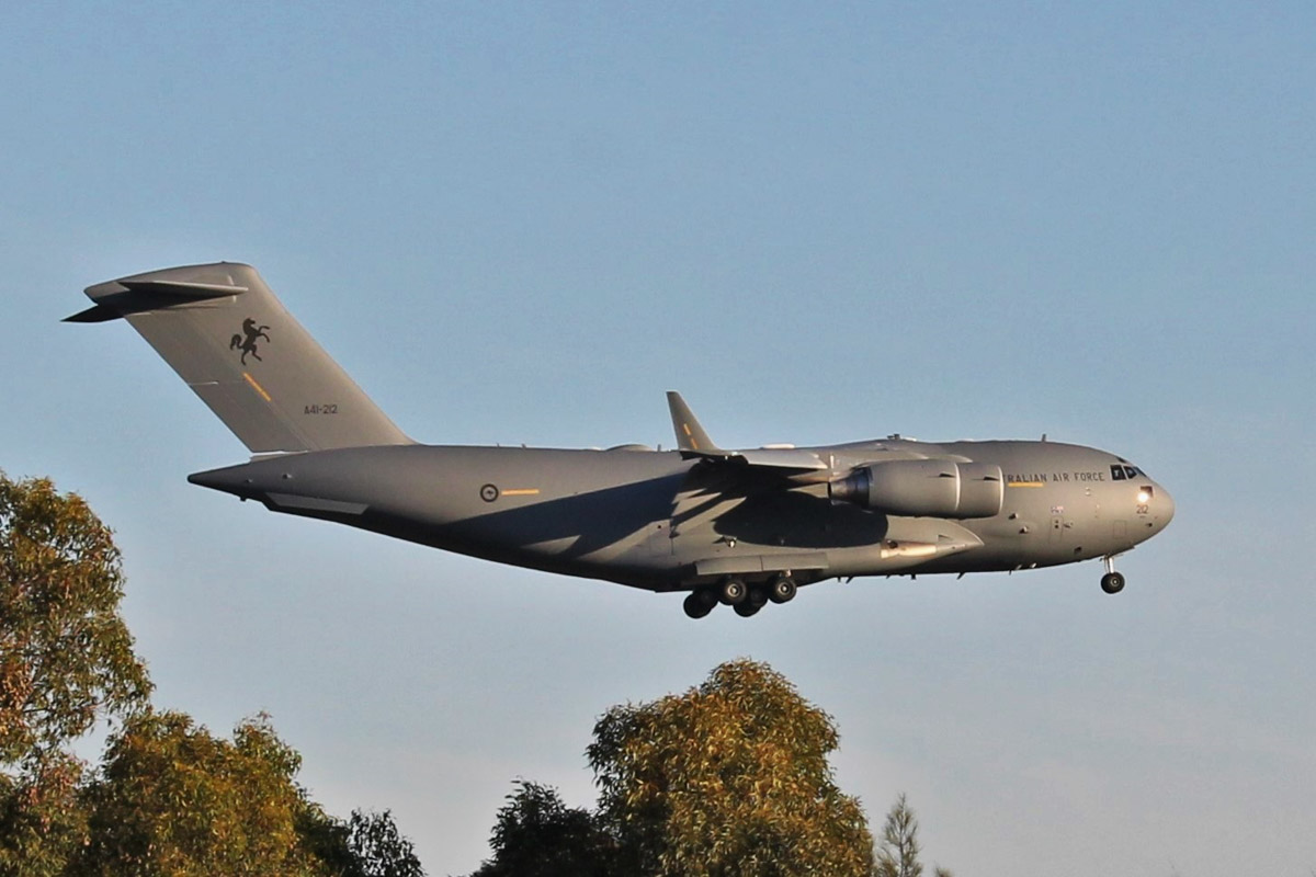 A41-212 Boeing C-17A Globemaster III (MSN 50271/F-270/AUS-7) of 36 Squadron, RAAF, at RAAF Base Pearce - Wed 11 November 2015. This is the eighth and final C-17 to be delivered to the RAAF, received only a few days before this photo. Initially allocated USAF serial 14-0001, on 20 June 2014 it was registered N270ZD to Boeing Co. Long Beach, California, until 3 June 2015. Allocated RAAF serial A41-212, on 2 November 2015 it arrived at its home base, RAAF Amberley in Queensland and on 5 November 2015 was present at an acceptance ceremony marking the final C-17 delivery. This aircraft has been operating on exercises in the Perth area for a few days. It is seen here passing over Great Northern Highway as it landed on runway 23. Photo © Jonathan Williams