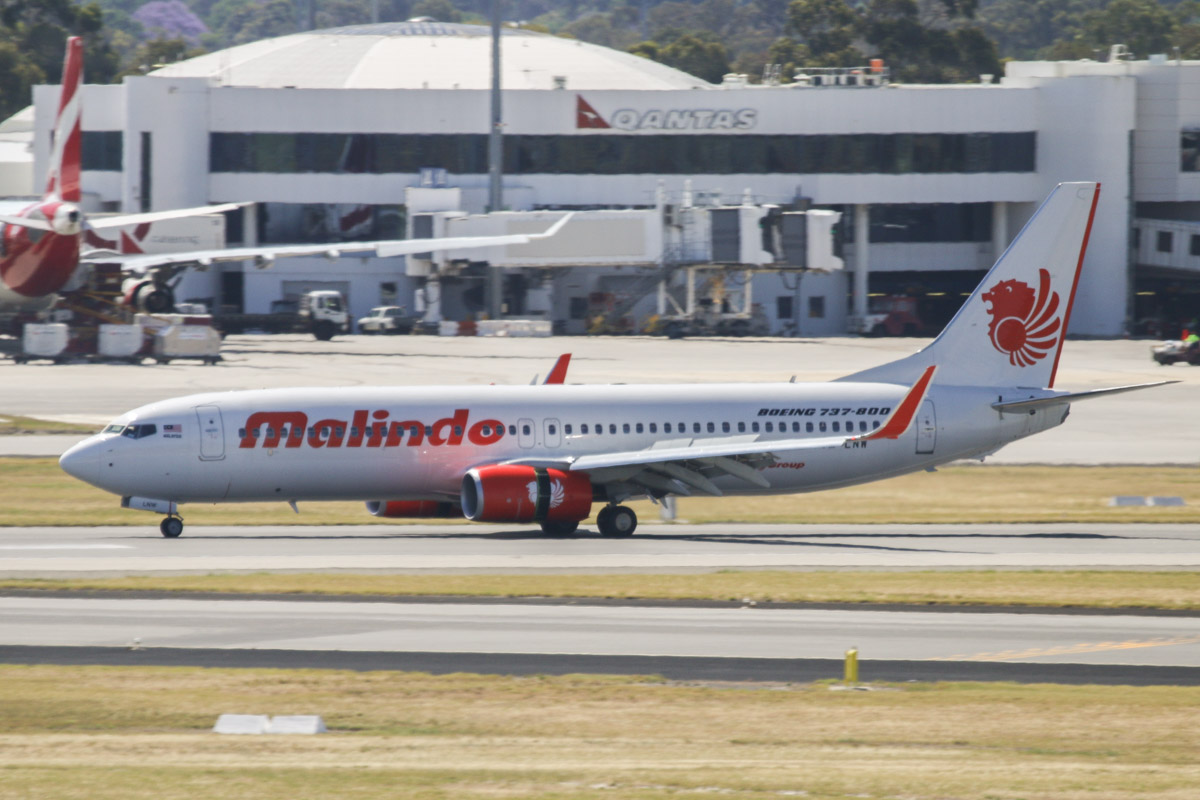 9M-LNW Boeing 737-8GP (MSN 39875/5616) of Malindo Air, at Perth Airport - Thu 19 November 2015. First service to Australia by Malindo Air. Flight OD151 from Kuala Lumpur, landing on runway 21 at 2:41pm. The first service was operated by a Boeing 737-800, but they are supposed to use a 737-900ER. The inaugural flight departed Kuala Lumpur over an hour late at 9:32am (scheduled departure is 8:25am), but made up time en route, arriving 36 minutes late, after a flight time of 5 hours 7 minutes. 9M-LNW is a recent addition to Malindo's fleet; it first flew on 6 October 2015 and was delivered on 17 October 2015. Photo © David Eyre