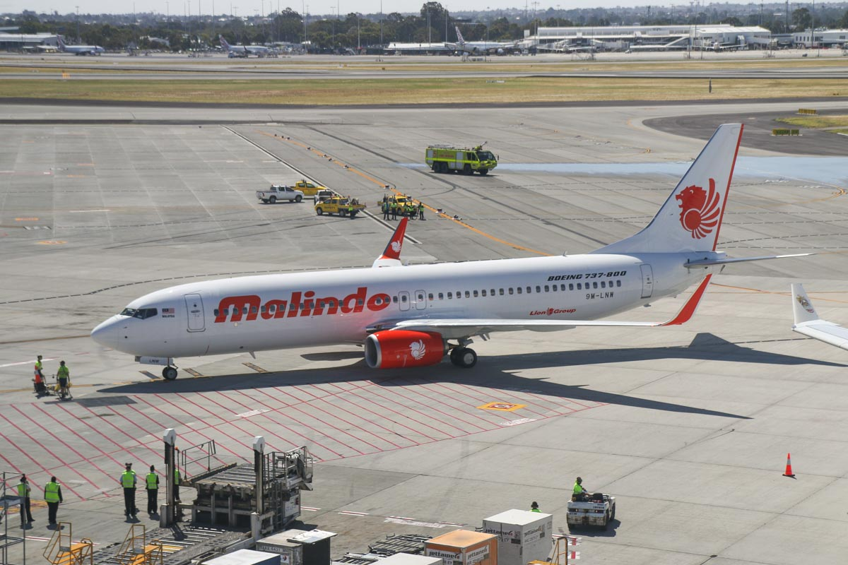 9M-LNW Boeing 737-8GP (MSN 39875/5616) of Malindo Air, at Perth Airport - Thu 19 November 2015. First service to Australia by Malindo Air. Flight OD151 from Kuala Lumpur landed on runway 21 at 2:41pm and is seen here taxying to park at Bay 151A at 2:46pm. The first service was operated by a Boeing 737-800, but they are supposed to use a 737-900ER. The inaugural flight departed Kuala Lumpur over an hour late at 9:32am (scheduled departure is 8:25am), but made up time en route, arriving 36 minutes late, after a flight time of 5 hours 7 minutes. 9M-LNW is a recent addition to Malindo's fleet; it first flew on 6 October 2015 and was delivered on 17 October 2015. Photo © David Eyre