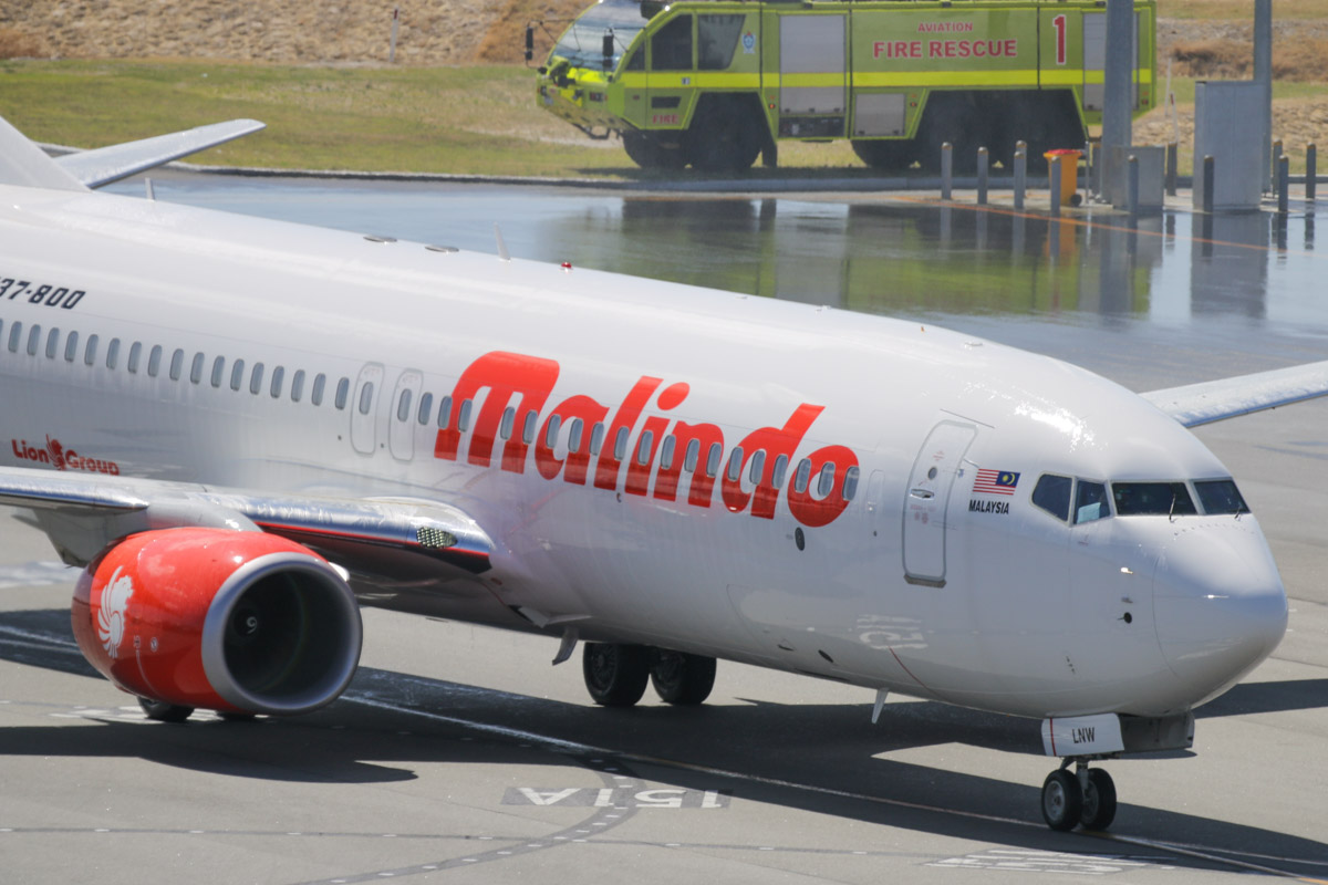 9M-LNW Boeing 737-8GP (MSN 39875/5616) of Malindo Air, at Perth Airport - Thu 19 November 2015. First service to Australia by Malindo Air. Flight OD151 from Kuala Lumpur landing on runway 21 at 2:41pm and is seen here after being greeted by a water cannon salute from local fire fighting crews. The first service was operated by a Boeing 737-800, but they are supposed to use a 737-900ER. The inaugural flight departed Kuala Lumpur over an hour late at 9:32am (scheduled departure is 8:25am), but made up time en route, arriving 36 minutes late, after a flight time of 5 hours 7 minutes. 9M-LNW is a recent addition to Malindo's fleet; it first flew on 6 October 2015 and was delivered on 17 October 2015. Photo © David Eyre