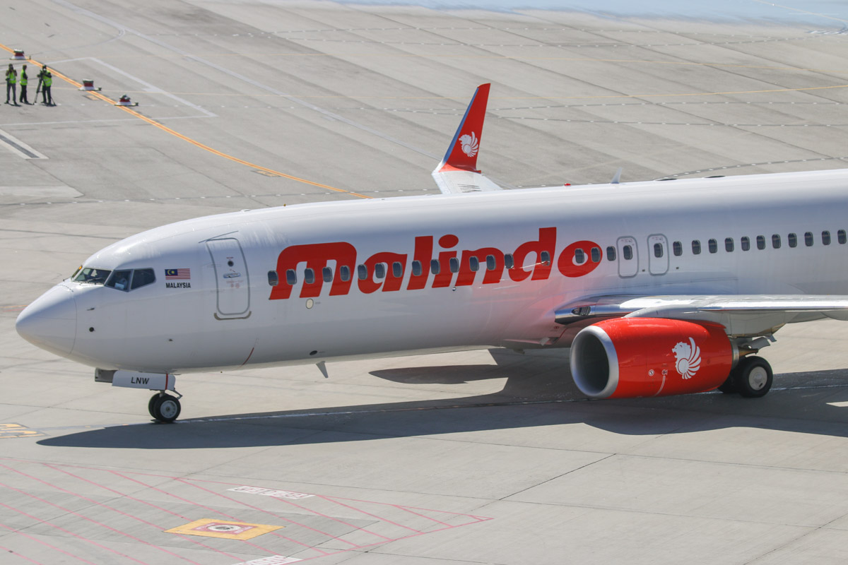 9M-LNW Boeing 737-8GP (MSN 39875/5616) of Malindo Air, at Perth Airport - Thu 19 November 2015. First service to Australia by Malindo Air. Flight OD151 from Kuala Lumpur landed on runway 21 at 2:41pm and is seen here taxying to park at Bay 151 at 2:46pm. The first service was operated by a Boeing 737-800, but they are supposed to use a 737-900ER. The inaugural flight departed Kuala Lumpur over an hour late at 9:32am (scheduled departure is 8:25am), but made up time en route, arriving 36 minutes late, after a flight time of 5 hours 7 minutes. 9M-LNW is a recent addition to Malindo's fleet; it first flew on 6 October 2015 and was delivered on 17 October 2015. Photo © David Eyre