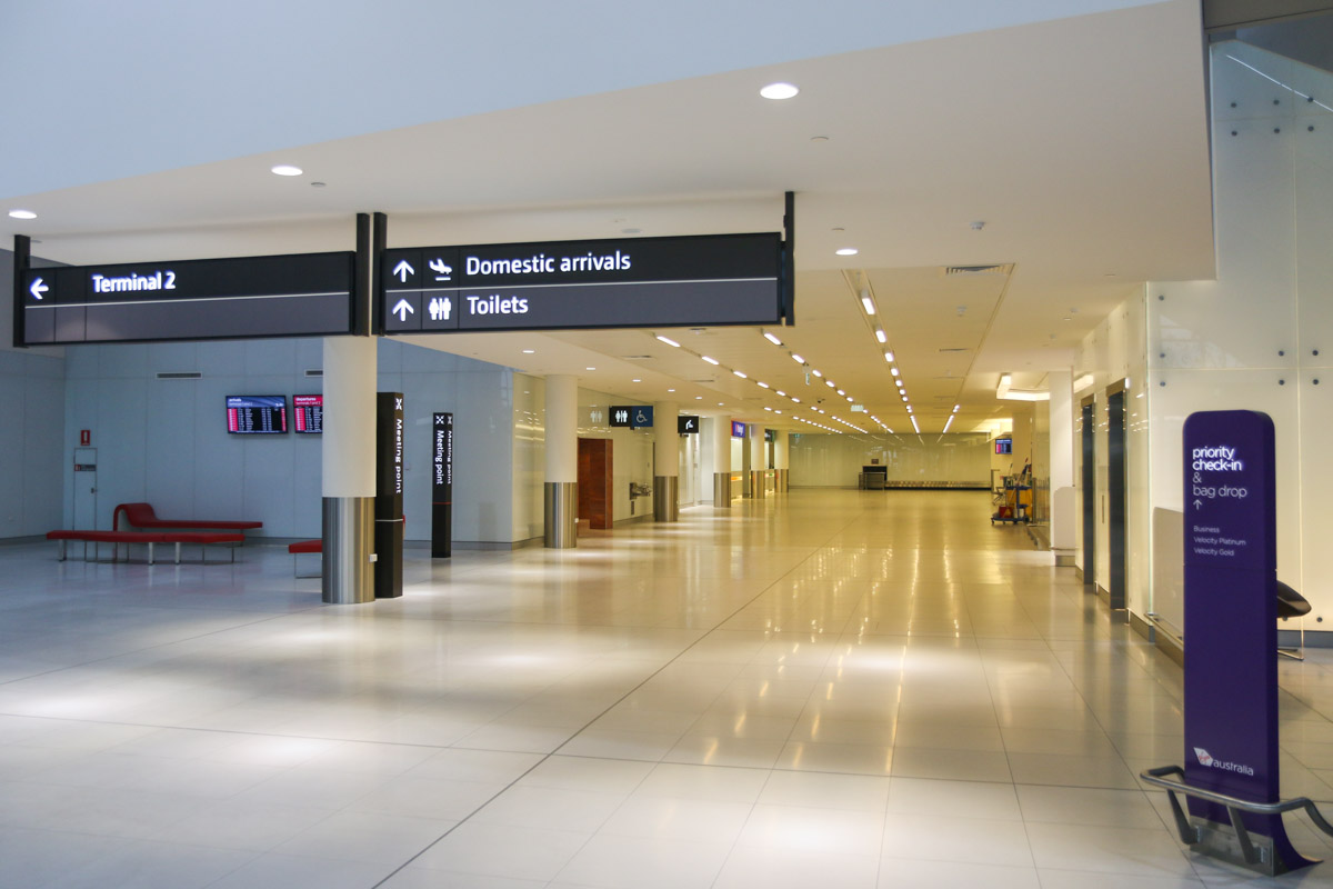 Terminal 1 Domestic on the first day of operations, Perth Airport - Sun 22 November 2015. Domestic arrivals area, with walkway to Terminal 2 off photo to the left. Photo © David Eyre