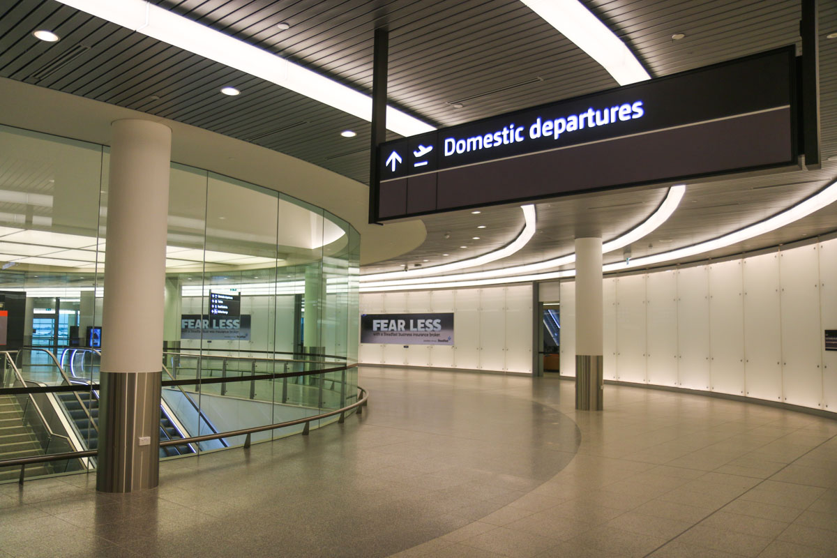 Terminal 1 Domestic on the first day of operations, Perth Airport - Sun 22 November 2015. After passing through security screening, passengers walk around here to the Departure Lounge, just visible in the background on the left. Photo © David Eyre