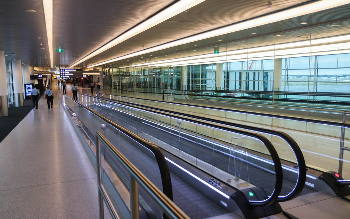 Terminal 1 Domestic on the first day of operations, Perth Airport - Sun 22 November 2015. Moving walkway to the Departure Lounge. Off photo to the right is the Terminal 1 International, with Bay 151 (A380 gate) immediately outside. Photo © David Eyre