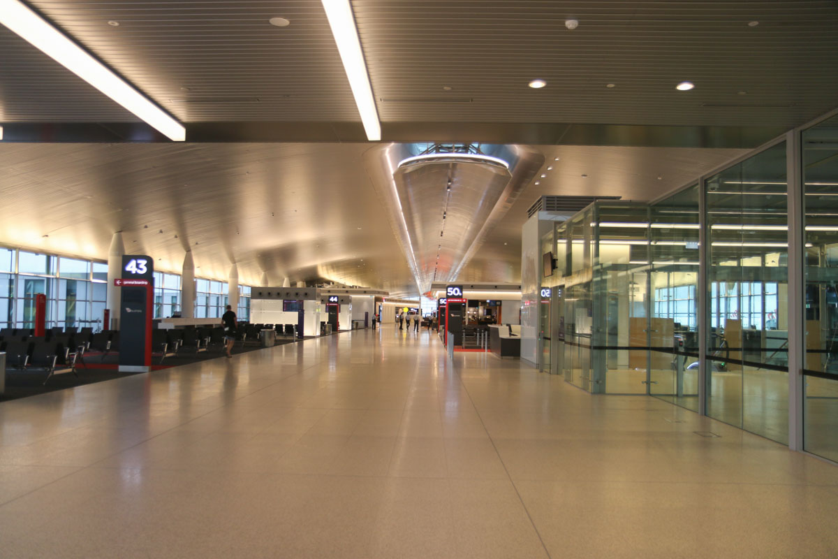 Terminal 1 Domestic on the first day of operations, Perth Airport - Sun 22 November 2015. Entering the Departure Lounge and Pier. Off photo to the right is the International/Domestic gate 50B, which is segregated from domestic passengers by a glass partition. Photo © David Eyre
