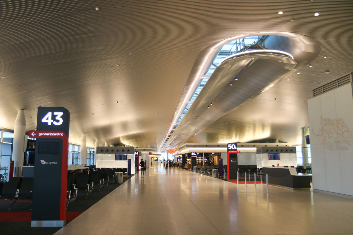 Terminal 1 Domestic on the first day of operations, Perth Airport - Sun 22 November 2015. Entering the Departure Lounge and Pier, with Gates 43 and 44 on the left, and 50A and 50B on the right. Photo © David Eyre