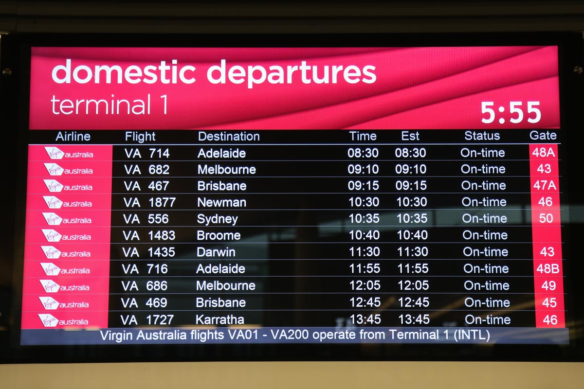Terminal 1 Domestic on the first day of operations, Perth Airport - Sun 22 November 2015. Domestic departures screen at 5:55am, showing the first departures at the new terminal. VA714 (operated by Embraer E190 VH-ZPN) was the first flight to depart from the new terminal, after arriving as VA713 from Adelaide. Photo © David Eyre