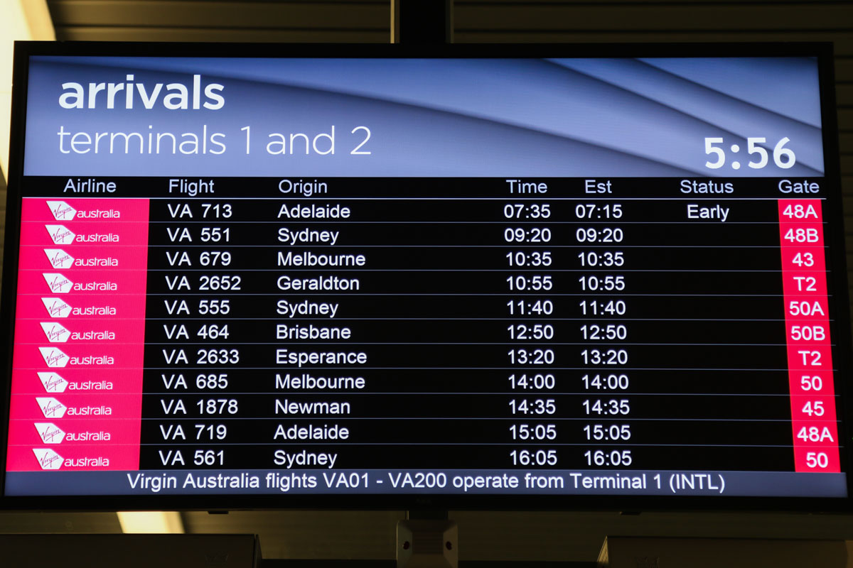Terminal 1 Domestic on the first day of operations, Perth Airport - Sun 22 November 2015. Domestic arrivals screen at 5:56am, showing the first arrivals at the new terminal, but also includes arrivals for Terminal 2 next door. VA713 (operated by Embraer E190 VH-ZPN) was the first flight use the new terminal, after arriving from Adelaide. Photo © David Eyre