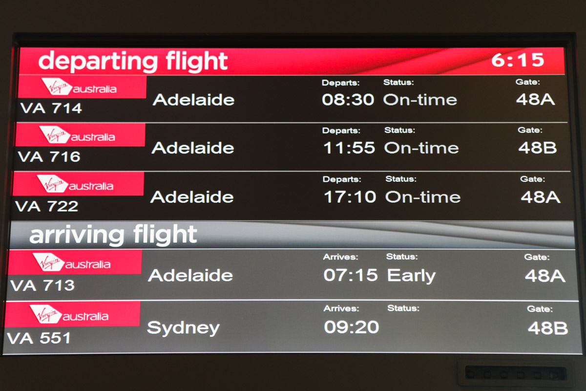 Terminal 1 Domestic on the first day of operations, Perth Airport - Sun 22 November 2015. Each gate has a screen showing which flights are departing from that particular gate. VA714 (operated by Embraer E190 VH-ZPN) was the first flight to depart from the new terminal, after arriving as VA713 from Adelaide. Photo © David Eyre