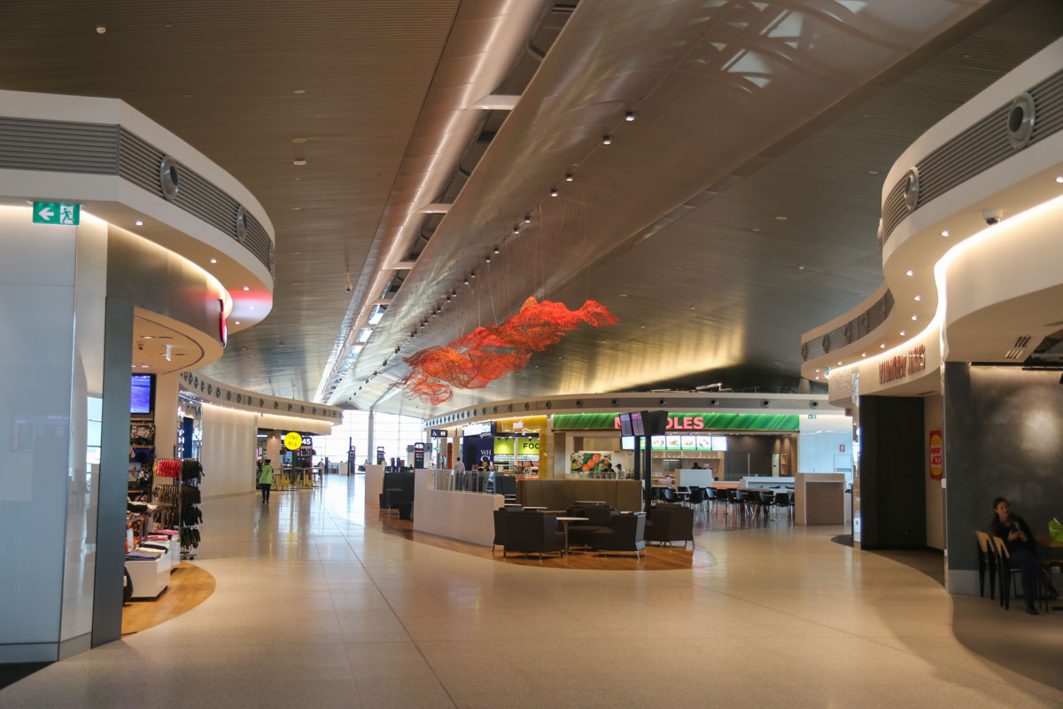 Terminal 1 Domestic on the first day of operations, Perth Airport - Sun 22 November 2015. Facing west along the terminal pier, with the food court on the right, on the north side of the terminal, near gate 50. Photo © David Eyre