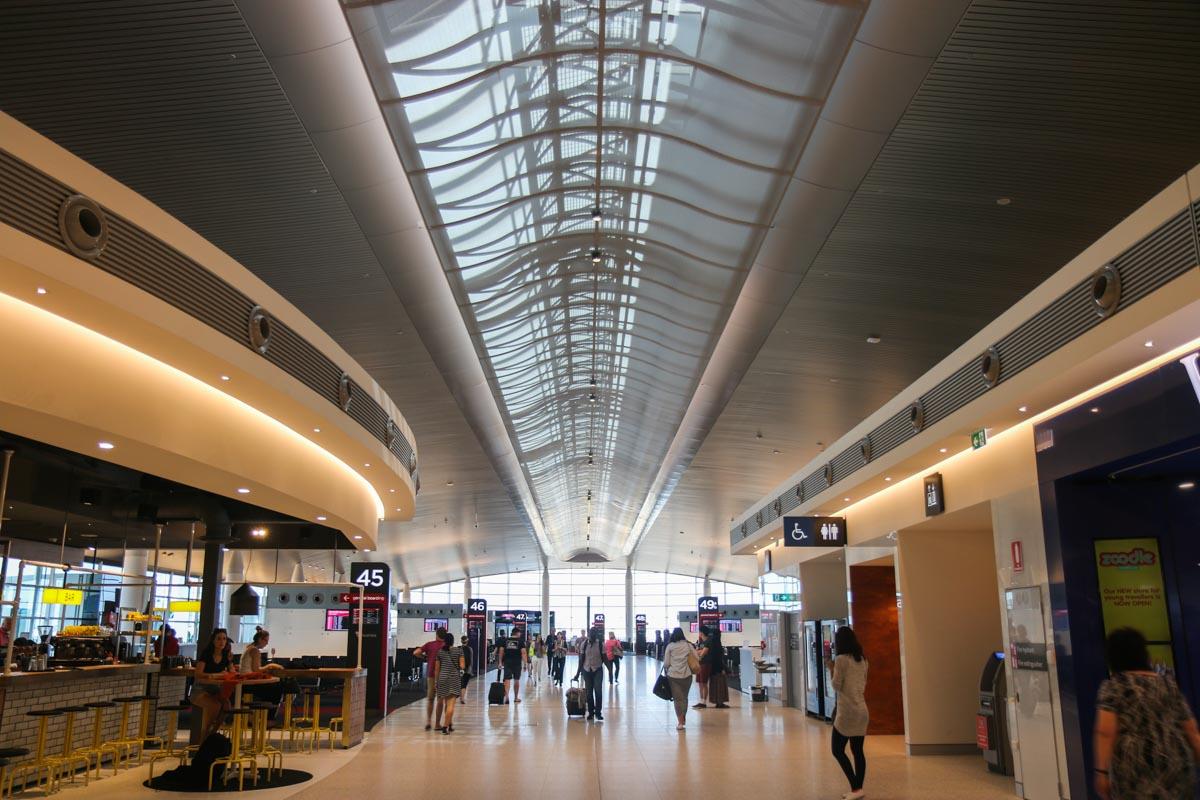 Terminal 1 Domestic on the first day of operations, Perth Airport - Sun 22 November 2015. View west along the new Terminal pier, with a bar on the left and toilets on the right. Photo © David Eyre