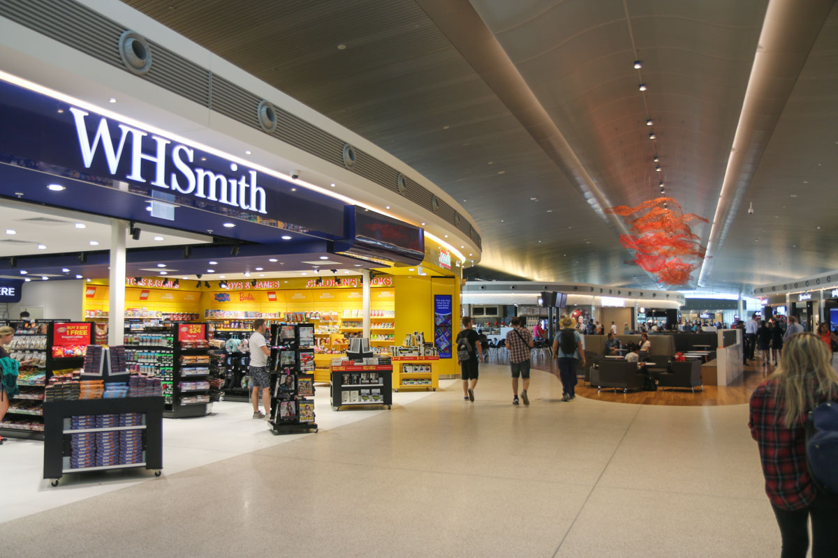 Terminal 1 Domestic on the first day of operations, Perth Airport - Sun 22 November 2015. View east, from the west end of the new Terminal pier, with a newsagent and toyshop on the left and the food court beyond. Photo © David Eyre